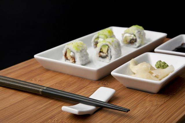 sushi met chop sticks