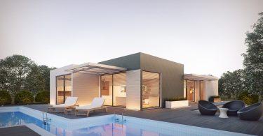 modern huis met ligstoelen aan zwembad
