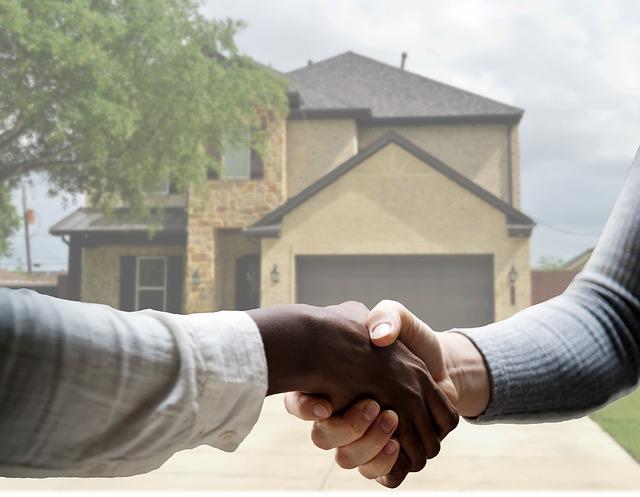 handen schudden voor woning