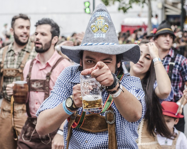 man with beer and grey hat