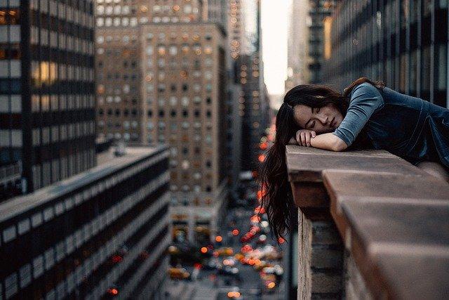 woman hanging over balcony