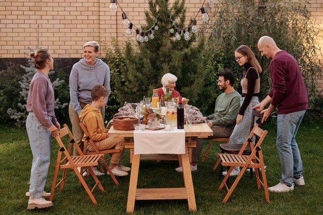 friends in garden at table